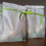 A small, decorated paperbag filled with sweets.